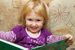 Small girl with the book royalty free stock photography