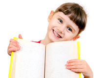 Small Girl with a Book. Cheerful Small Girl with the opened Book Isolated on the White Background Stock Image