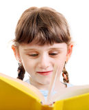 Small Girl with a Book. Isolated on the White Background Stock Photos