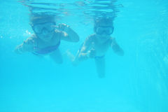 Small girl and boy as divers Royalty Free Stock Images