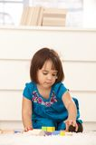 Small girl with building block Royalty Free Stock Photos