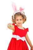 Small girl with bunny ears giving Easter egg Stock Photos