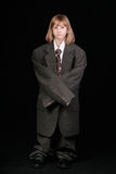 Small girl in business suit Stock Photos