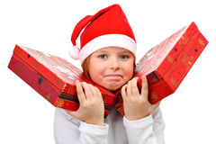 Small girl carrying two large presents isolated Royalty Free Stock Photos