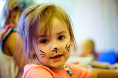 Small girl with cats face art royalty free stock photography
