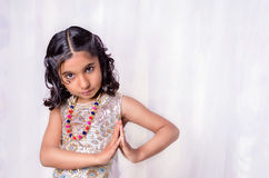 Small girl child with folded hands Royalty Free Stock Photo