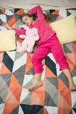 Small girl child ready to sleep. Time to relax. Childhood happiness. Pajama party. Good night. Little happy girl in. Bedroom. Good morning. International stock images