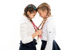 Small girl children with perfect hair. Childhood happiness. Friendship and sisterhood. childrens day. Back to school. Small kid fashion. Happy little sisters stock image