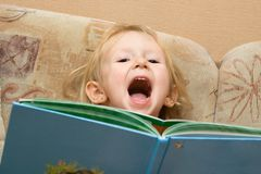 Small  girl with children's book Stock Photo