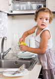 Small girl chores washing dishes Royalty Free Stock Image