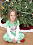 Small girl by Christmas tree royalty free stock image