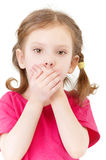 Small girl closes mouth hands Stock Photos