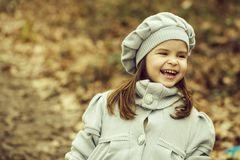 Small girl in autumn park stock photos