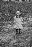 Small girl in autumn park royalty free stock photo