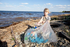Small Girl Collecting Rubbish Stock Image