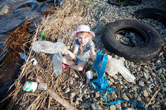 Small girl collecting rubbish Royalty Free Stock Photo
