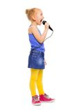 Small girl in colorful clothes singing alone Stock Photography