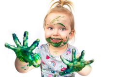 Small girl with colorful hands Royalty Free Stock Photo