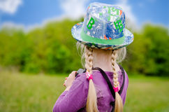 Small girl in a colorful outfit on a country track Stock Photos