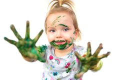 Small girl with colorful hands Stock Image