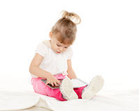 Small girl with computer tablet. Royalty Free Stock Image
