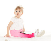 Small girl with computer tablet. Royalty Free Stock Photos
