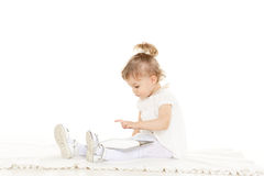 Small girl with computer tablet. Stock Images