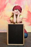 Small girl cook in hat with blackboard. Stock Photos