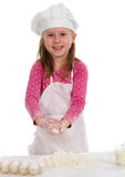 Small girl cooking Stock Photos