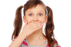 Small girl covering her mouth Stock Images