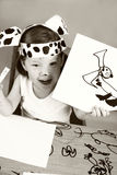 Small girl with dalmatian mask Stock Photography