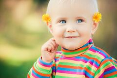 Small girl with dandelions Stock Photography