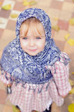 the small girl in a dark blue scarf Stock Photography