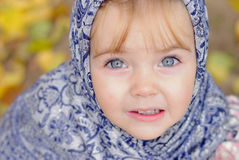 The small girl in a dark blue scarf Royalty Free Stock Photography