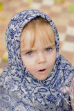 The small girl in a dark blue scarf Royalty Free Stock Photos