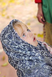The small girl in a dark blue scarf Royalty Free Stock Images