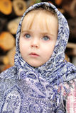 The small girl in a dark blue scarf Stock Photo