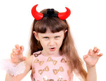 Small Girl with Devil Horns. Isolated on the White Background Royalty Free Stock Images
