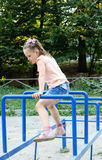 Small girl doing sports exercises in the park Stock Photo
