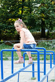 Small girl doing sports exercises in the park Royalty Free Stock Photos