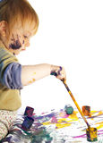 Small girl draws. The little girl draws on a paper isolated Stock Image