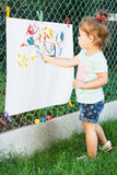 Small girl draws by watercolor Stock Photography