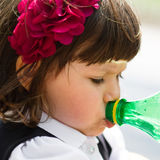 Small girl drinking water from bottle Stock Image