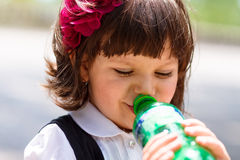 Small girl drinking water from bottle Royalty Free Stock Image