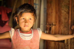 Small girl with earrings  in Nepal Royalty Free Stock Image