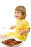 Small girl eat corn flakes Stock Photography