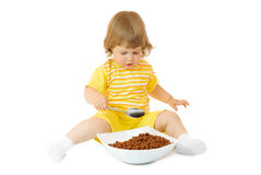 Small girl eat corn flakes Stock Image