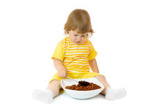 Small girl eat corn flakes Stock Photos