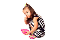 Small girl eat corn flakes. Studio shoot Royalty Free Stock Photography