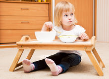 A small girl is eating Royalty Free Stock Photos